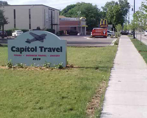 Capitol Travel freestanding sign